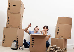 Couple surrounded by moving boxes